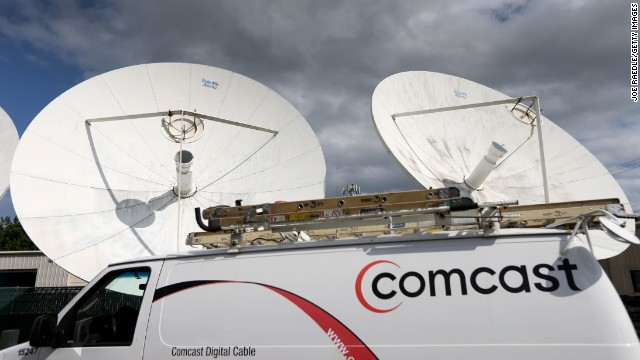 POMPANO BEACH, FL - FEBRUARY 13: A Comcast truck is seen parked at one of their centers on February 13, 2014 in Pompano Beach, Florida. Today, Comcast announced a $45-billion offer for Time Warner Cable. (Photo by Joe Raedle/Getty Images)