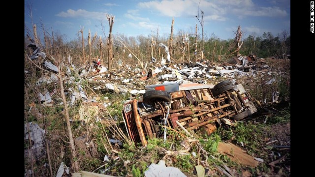 "MAYFLOWER, AR:  ""It's total devastation in Faulkner County, Arkansas after a tornado shattered homes and killed 10 people in the towns of Vilonia and Mayflower on Sunday."" - CNN's Josh Rubin, April 28.  The scope is staggering. Some 75 million Americans are under threat of severe weather on Tuesday.  People from the Great Lakes to the Gulf Coast, and from the Midwest to the East Coast, are advised to keep their eyes to the sky and their ears to the radio. That's a third of the country.  The greatest risk will again be in the Deep South, with Mississippi and Alabama in the bull's eye for the worst of the storms.   FULL STORY AT CNN.COM."