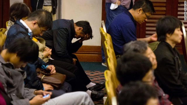 Relatives of Chinese passengers onboard the missing Malaysia Airlines MH370 plane listen to a briefing by members of the team tasked with searching for the plane at a hotel in Beijing, China, Tuesday, April 29, 2014. The search team release snippets of the audio between the pilot and the control tower and answered questions relatives has regarding the satellite data used to determine the possible location of the plane. (AP Photo/Relatives of Chinese passengers onboard the missing Malaysia Airlines MH370 plane listen to a briefing by members of the team tasked with searching for the plane at a hotel in Beijing, China, Tuesday, April 29, 2014. The search team release snippets of the audio between the pilot and the control tower and answered questions relatives has regarding the satellite data used to determine the possible location of the plane. (AP Photo/Ng Han Guan))