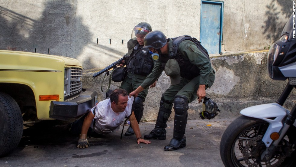 Members of the Venezuelan National Guard detain a man during a protest against the government of President Nicolas Maduro in Caracas, Venezuela, on Saturday, April 26. Over several months, protesters unhappy with Venezuela's economy and rising crime have squared off against security forces.
