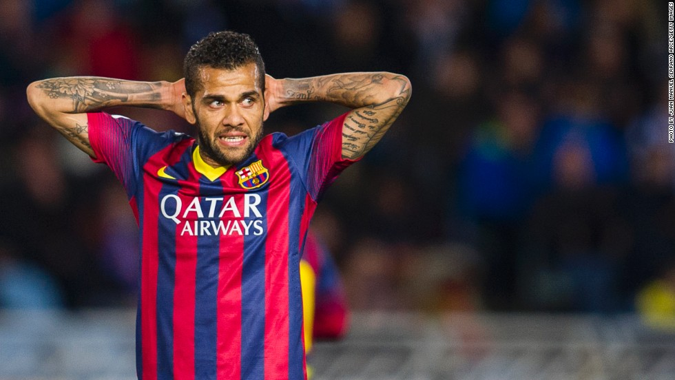 Dani Alves responded by picking up a banana and eating it after finding himself the target of racial abuse during Barcelona's 3-2 win at Villarreal Sunday.