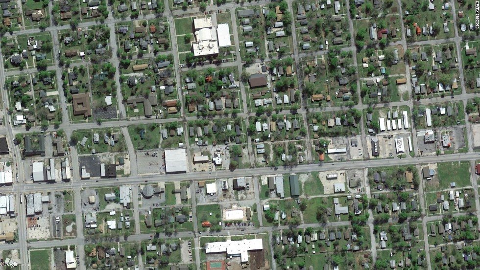 A powerful storm system, including some tornadoes, has claimed more than two dozen lives across several states this week. Satellite images recorded before and after the storms reveal the devastation. Pictured here is Baxter Springs, Kansas, in April 2013.