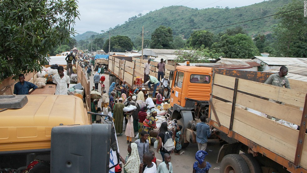 "Muslims leave the PK12 neighborhood of Bangui on April 27. ""Since December, nearly one million people in CAR have fled their homes amid brutal attacks and reprisals by warring factions -- chiefly the Seleka and anti-Balaka militias,"" writes Tammi Sharpe, UNHCR's deputy representative in the country."