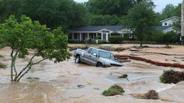 PENSACOLA, FL - APRIL 30:  A truck is stuck in the middle of flooded Piedmont Street in the Cordova Park neighborhood after it washed out due to heavy rains on April 30, 2014 in Pensacola, Florida. A major storm system that brought tornadoes to regions of the South dumped more than two feet of water in a little over a day in the Florida Panhandle. (Photo by Marianna Massey/Getty Images)