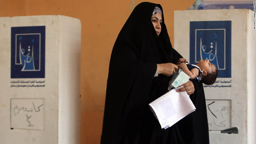"APRIL 30 - BASRA, IRAQ: A woman prepares to cast her vote for the parliamentary elections. <a href=""http://cnn.com/2014/04/30/world/meast/iraq-elections/index.html"">Iraq is holding its third poll</a> since the 2003 U.S.-led invasion that toppled dictator Saddam Hussein. 21.5 million voters are eligible to cast their ballots. More than 9,000 candidates are vying to fill 328 seats."