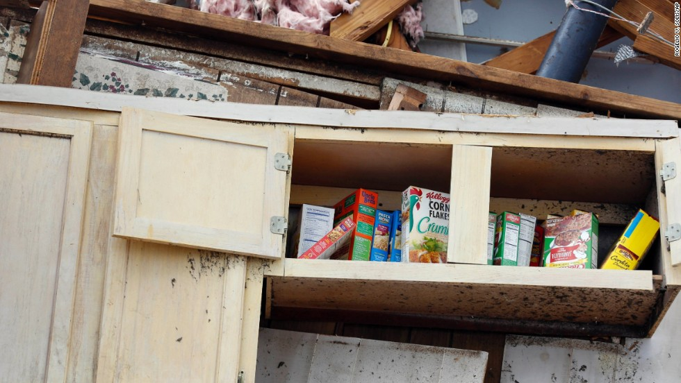 A kitchen shelf stands in what remains of a home in Louisville on April 29.