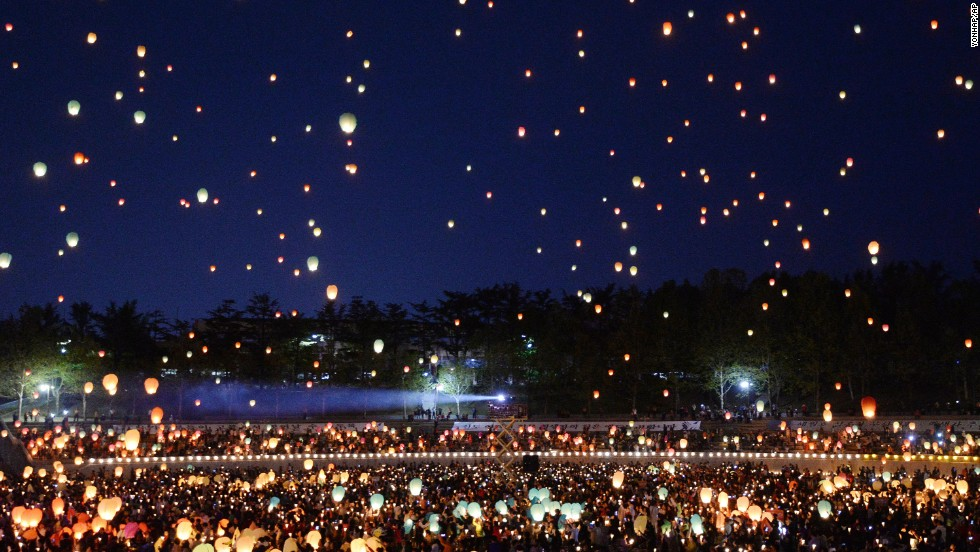 "Buddhists in Daegu, South Korea, release paper lanterns Saturday, April 26, in memory of those who were killed aboard the sunken ferry Sewol. More than 200 bodies have been found since <a href=""http://www.cnn.com/2014/04/15/asia/gallery/south-korea-sinking-ship/index.html"">the ferry sank</a> April 16 off South Korea's southwest coast."