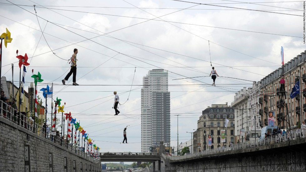 Tightrope walkers perform above a canal in Brussels, Belgium, on Saturday, April 26.