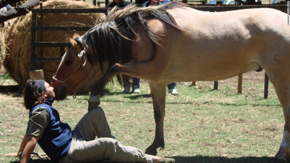 Scarpati, pictured here playing with a horse at the school, grew up in San Luis -- a mountain town at the base of the Sierras de Cordoba range.