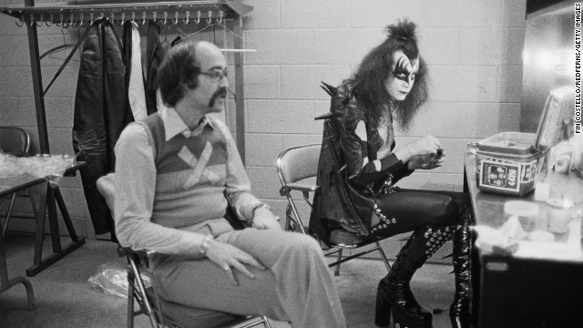 Gene Simmons, the vocalist of hard rock band KISS, backstage in Detroit with Larry Harris, May 1975. Harris is the co-founder of Casablanca Records, KISS' record label. (Photo by Fin Costello/Redferns/Getty Images)