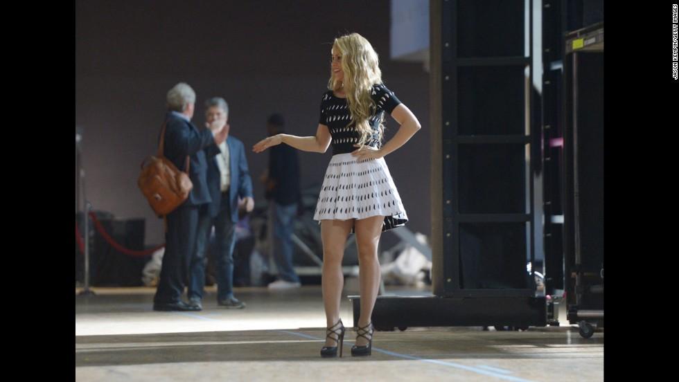 "Singer Shakira poses backstage.  She performed her song ""Empire."""