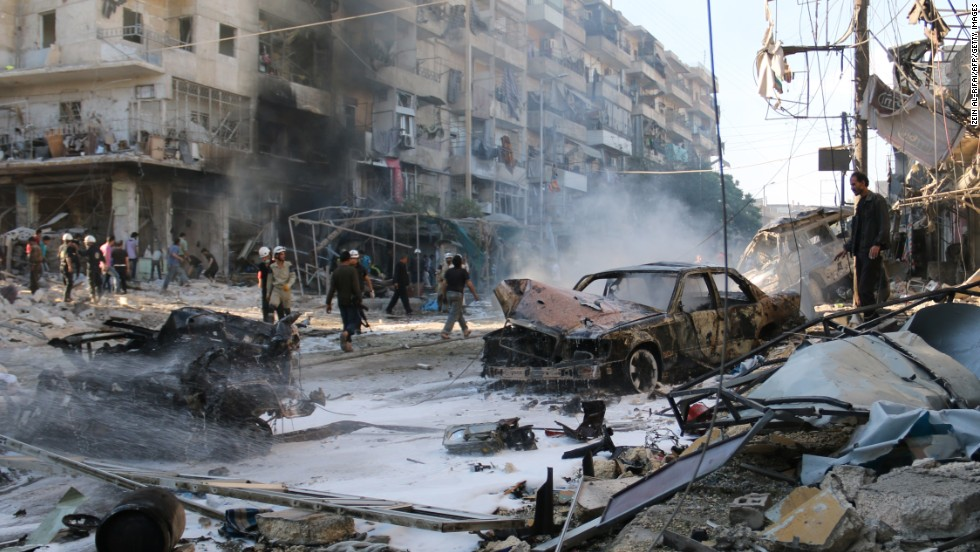Syrians gather at the site of reported airstrikes in Aleppo on May 1. According to the Syrian Observatory for Human Rights, at least 33 civilians were killed in the attack.