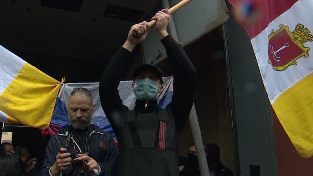 Activists storm police headquarters