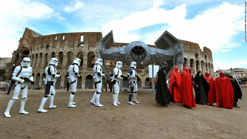 "Members of the ""Star Wars"" fan club celebrate May 4 (""Star Wars Day"") in front of the Colosseum in central Rome. Why May 4? It's related to a pun on ""May the Force be with you"" -- ""May the Fourth be with you."""