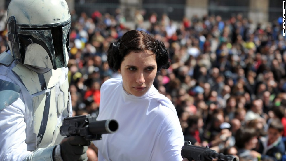"Members of a ""Star Wars"" fan club dress as characters from the movie outside Rome's Colosseum."