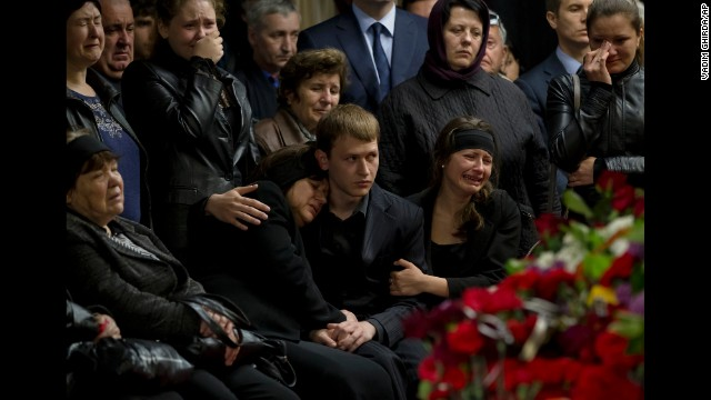 Mourners and family members cry next the coffin of regional parliament member Vyacheslav Markin, who was killed during clashes on May 2, in Odessa, Ukraine, on Monday, May 5.