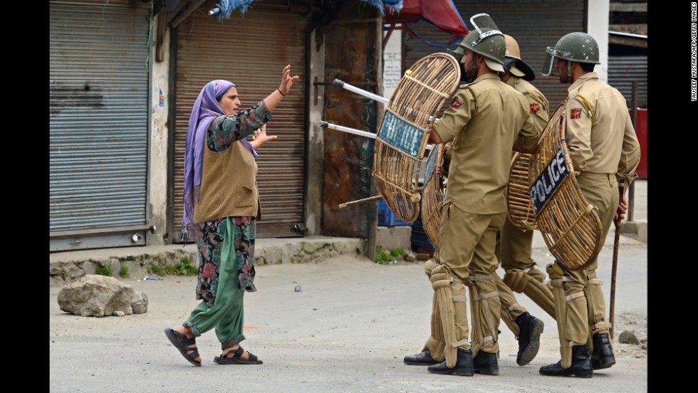 A Kashmiri Muslim woman confronts Indian police after they arrested a youth during a protest in Srinagar on May 2.