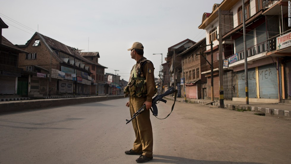 An Indian soldier stands in the middle of an empty Srinagar street Wednesday, April 30, following calls by rebels and separatist politicians to boycott the parliamentary elections.