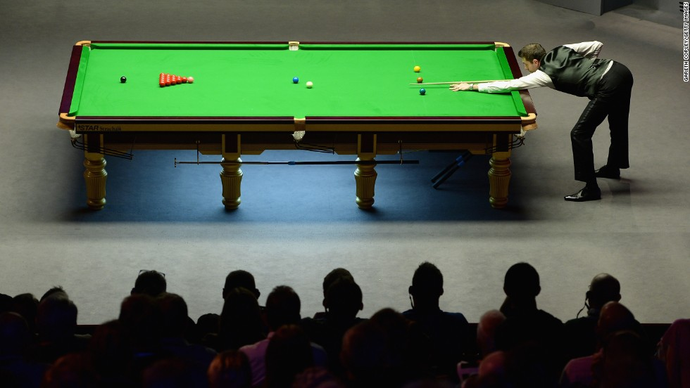 Mark Selby plays a shot during the World Snooker Championship final Sunday, May 4, in Sheffield, England. Selby defeated Ronnie O'Sullivan to win his first world championship and prevent O'Sullivan from winning his third straight.
