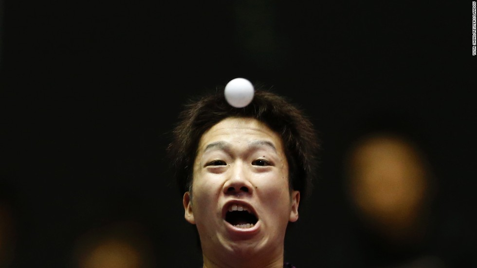 Japan's Jun Mizutani eyes the ball as he hits a return during a match at the World Team Table Tennis Championships in Tokyo on Tuesday, April 29. China eventually won both the men's and women's competitions.