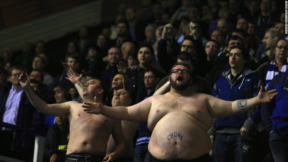 Two shirtless supporters of the Wigan Athletic soccer club are seen during Wigan's match at Birmingham City on Tuesday, April 29. Wigan won the match 1-0 to clinch a playoff spot in the the second division of English soccer.