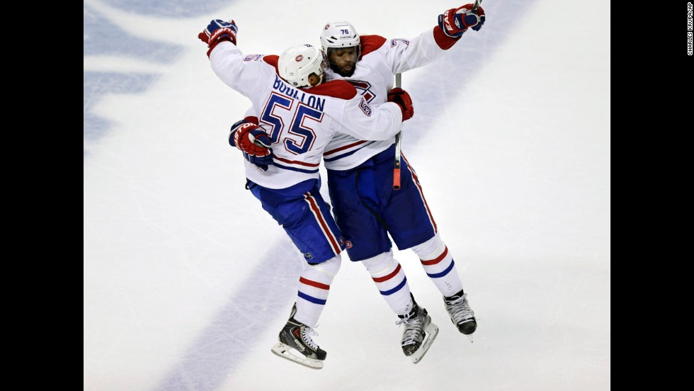 Montreal Canadiens defenseman Francis Boullion leaps into the arms of teammate P.K. Subban on Thursday, May 1, after Subban scored the game-winning goal against Boston in Game 1 of their NHL playoff series. The goal came in the second overtime period.