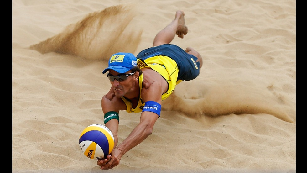 Beach volleyball player Emanuel Rego dives during a match Saturday, May 3, at the Shanghai Jinshan Grand Slam in China. Rego and Pedro Salgado lost in the semifinals to the eventual tournament winners, Paolo Nicolai and Daniele Lupo of Italy.