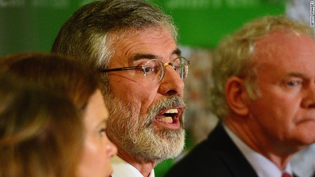 BELFAST, NORTHERN IRELAND - MAY 04: Sinn Fein Leader Gerry Adams (L) speaks alongside Deputy First Minister of Northern Ireland, Martin McGuinness, during a press conference at Balmoral Hotel after he was released from Antrim PSNI Station without charge following questioning over the Jean McConville murder, on May 4, 2014 in Belfast, Northern Ireland. (Photo by Jeff J Mitchell/Getty Images)