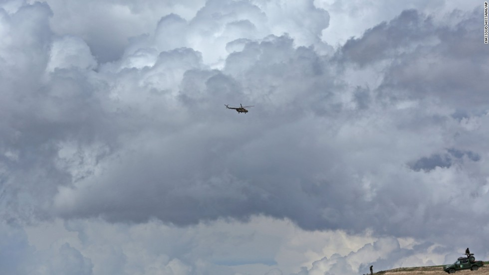 An Afghan National Army helicopter flies over the site on May 5.