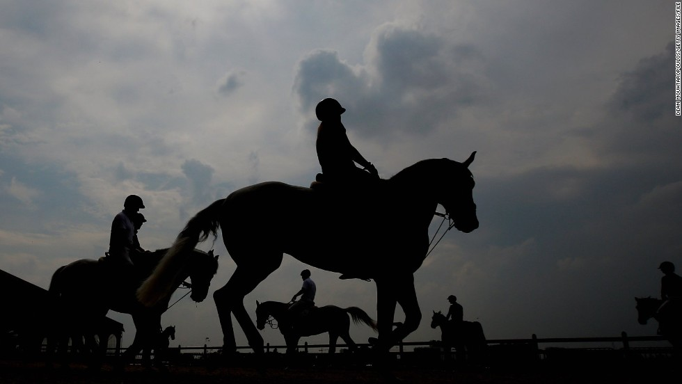 Riders and their horses warm up in the paddock during the Global Champions Tour of Antwerp in Belgium.