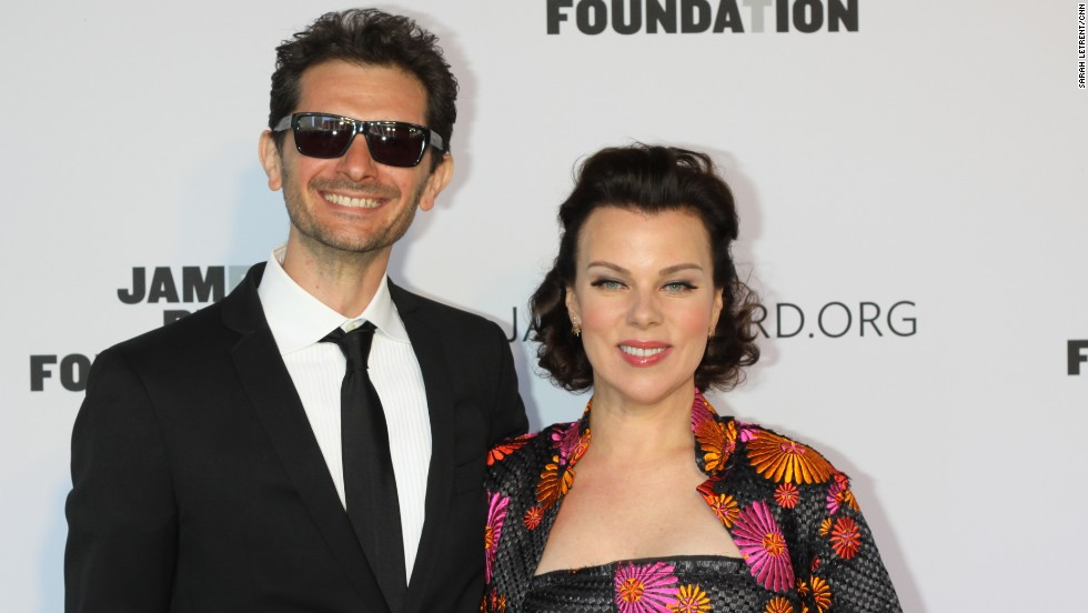 Gabriele Corcos and Debi Mazar of the show 'Extra Virgin' walk the red carpet at the James Beard Awards.