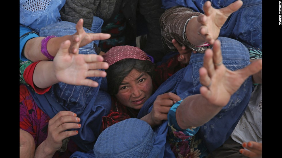 Survivors struggle for handouts near the site of the landslide on Monday, May 5. Relief agencies are racing to get vital supplies to the remote, mountainous area.