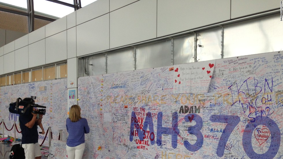 Day 10 -- A behind-the-scenes look at CNN's coverage of the search for MH370. Kate Bolduan and Hide Sato visit the Wall of Hope inside Kuala Lumpur International Airport.