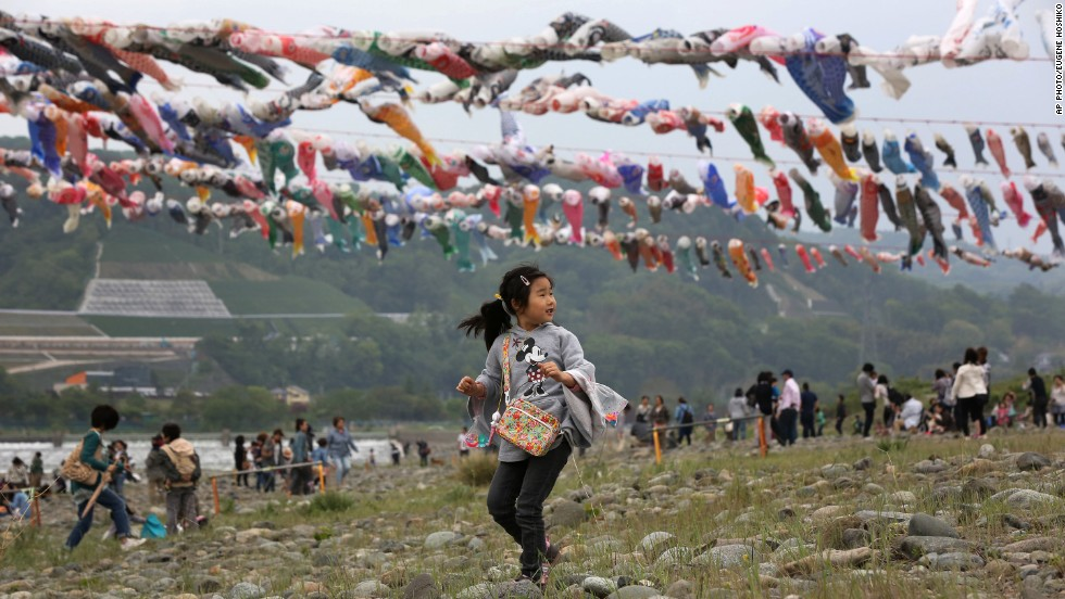 MAY 6 - TOKYO, JAPAN: Colorful carp streamers flutter in the air over the Sagami river as Japan celebrates the Children's Day national holiday. Carp, a symbol of strength and success, is traditionally featured during the festivities.