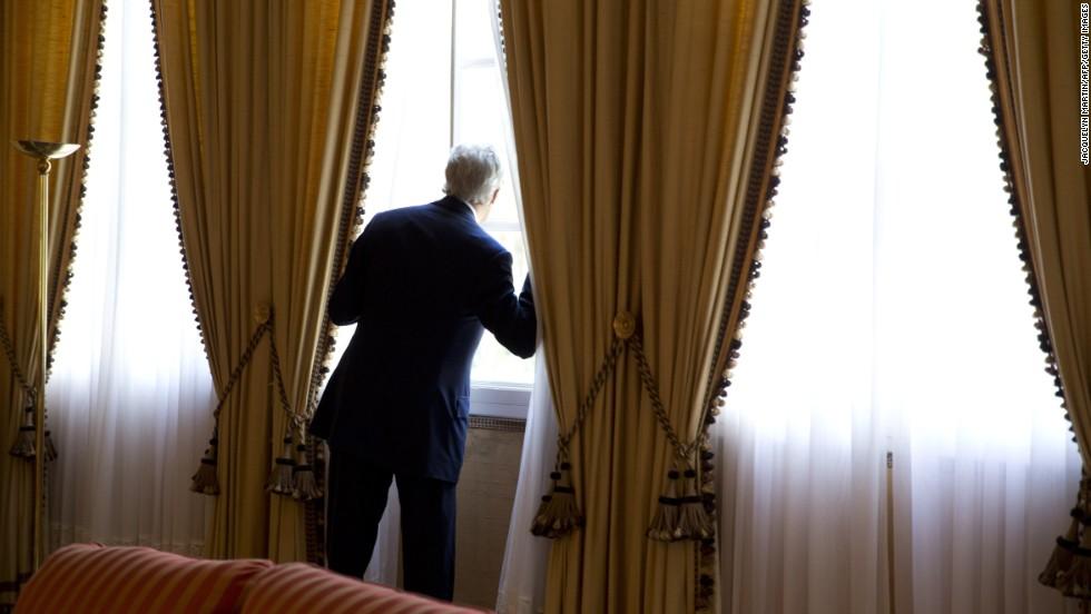Kerry looks out a window moments before meeting with Algerian President Abdelaziz Bouteflika in Zeralda, Algeria, in April 2014.