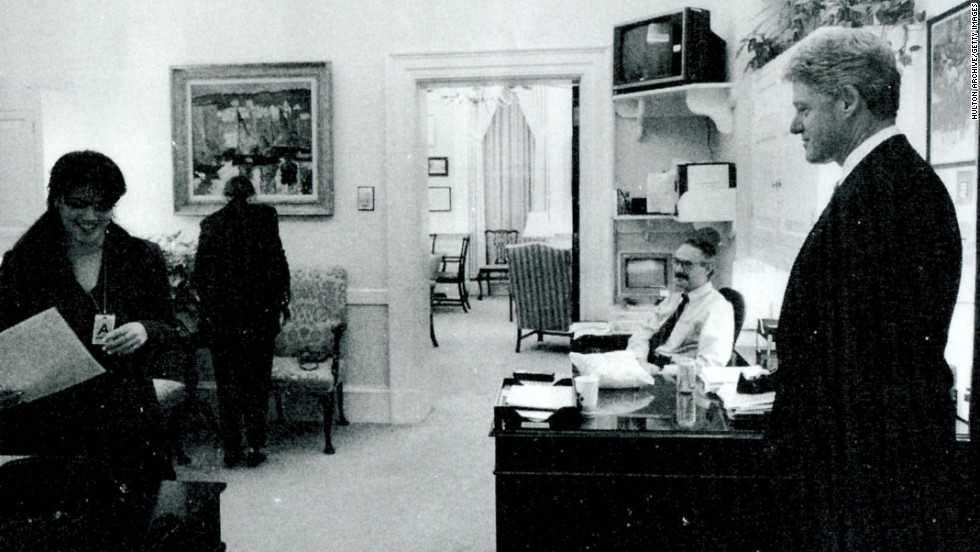 Another photograph submitted as evidence shows Lewinsky working in the White House office as President Clinton looks on.