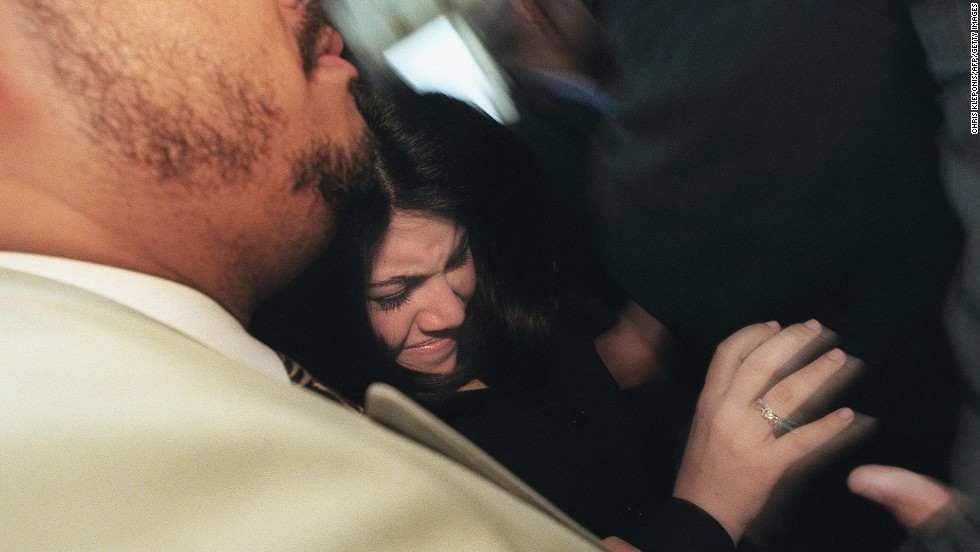 Lewinsky is pushed in a crowd of reporters after meetings with her attorneys in Washington in 1999.