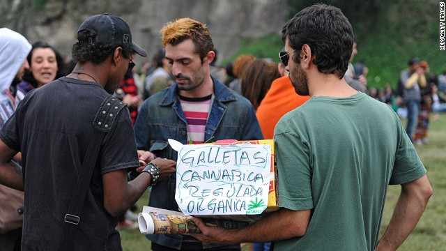 A man sells cannabis cookies during the World Day for the Legalization of Marijuana on May 3, 2014 in Montevideo. Uruguay Friday said that consumers can purchase up to 10 grams of marijuana per week at less than $1 per gram, as the country embarks on a unique experiment in drug regulation. AFP PHOTO / Miguel ROJOMIGUEL ROJO/AFP/Getty Images