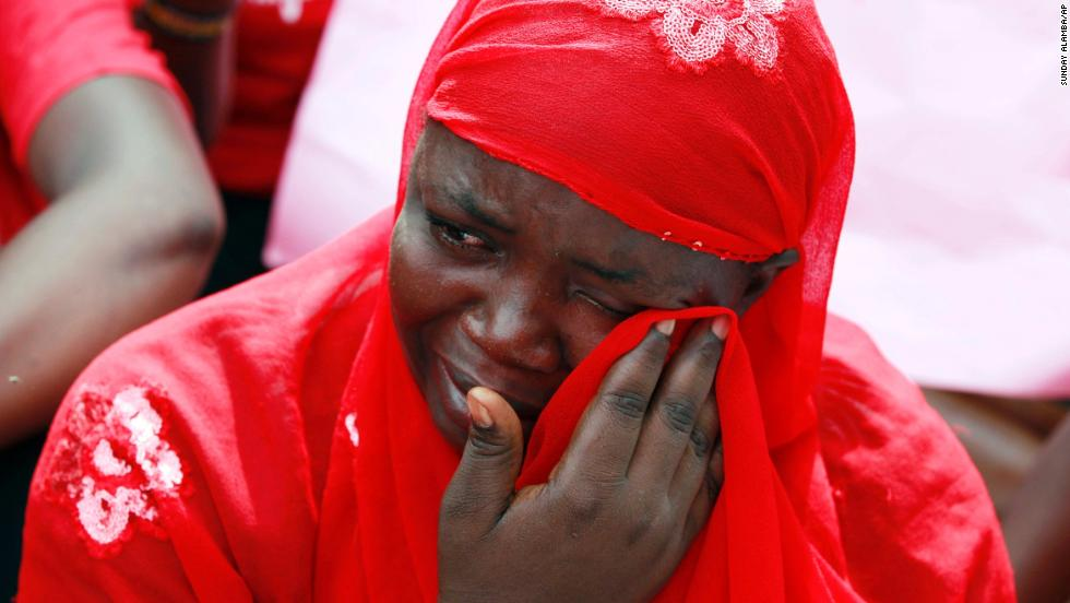 A woman attends a demonstration Tuesday, May 6, that called for the Nigerian government to rescue the girls.