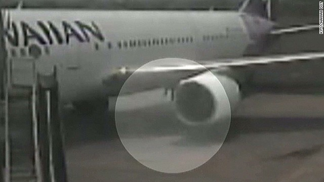 Video shows stowaway jump out of plane