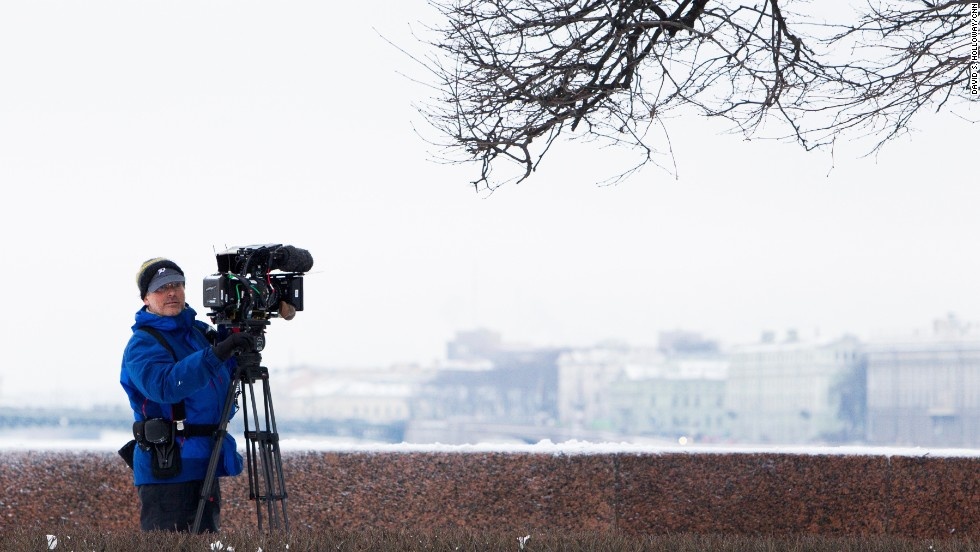Cameraman Todd Liebler films a scene along the frozen Neva River.