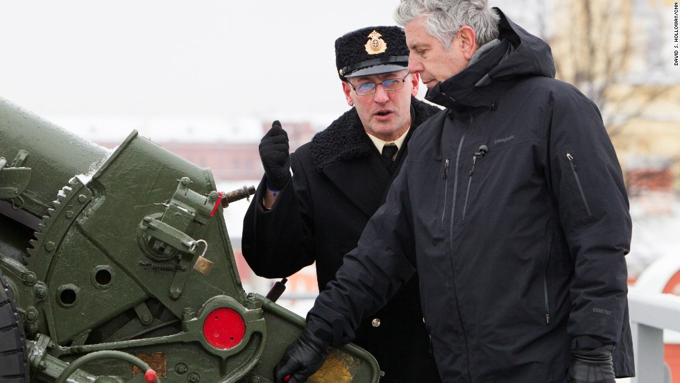 Bourdain prepares to fire a cannon at the Peter and Paul Fortress. The historic citadel served as a political prison for years before it was converted to a museum.