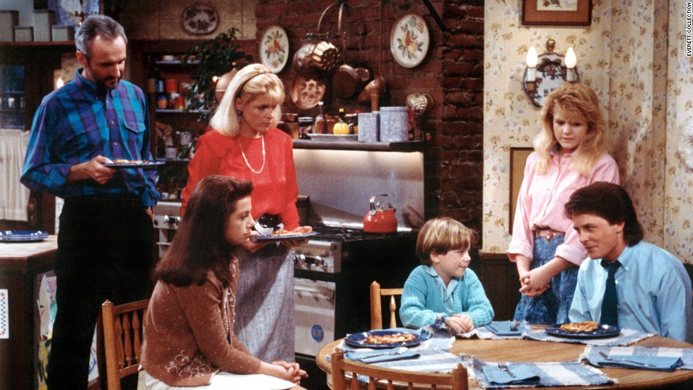 "In ""Family Ties,"" Elyse Keaton (Meredith Baxter, second from left) juggled life as an architect with a mother's sturdy guidance for her children (from left, Justine Bateman, Brian Bonsall, Tina Yothers and Michael J. Fox). Husband Steven (Michael Gross, far left) was an equal partner."