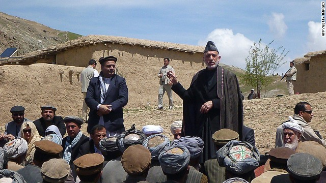 Afghan President Hamid Karzai (R) talks with displaced villagers during a visit to the site of a deadly landslide in Aab Bareek village in the Argo district of Badakhshan on May 7, 2014. Afghan officials said on May 5 they plan to build new houses for hundreds of families made homeless by a landslide that entombed a northeastern village and killed at least 300 people. A torrent of mud and rocks swept down a deep valley and levelled the village of Aab Bareek last on May 2 following heavy rain. At least 300 people were killed, according to local authorities, who warned that the toll could rise by hundreds more. AFP PHOTO/STRSTR/AFP/Getty Images
