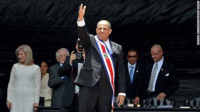 Costa Rican new President Luis Guillermo Solis waves during the swearing-in ceremony at the National Stadium in San Jose on May 8, 2014. Solis pledged to run his administration as a 'glass house' and tackle corruption 'eating away' at the country and economy as he was inaugurated Thursday. AFP PHOTO/EZEQUIEL BECERRA (Photo credit should read EZEQUIEL BECERRA/AFP/Getty Images)