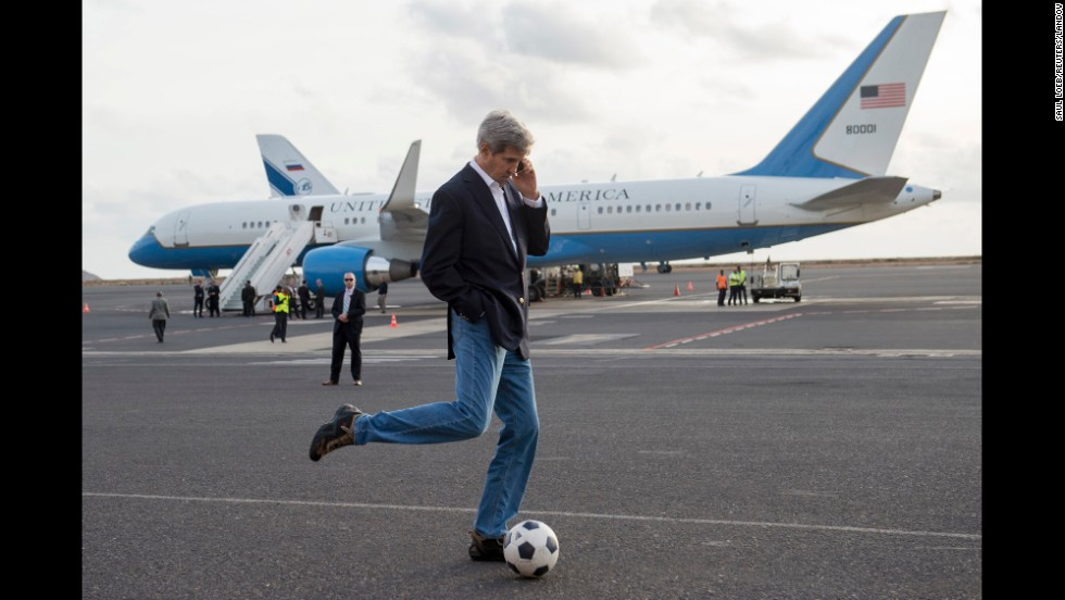 "U.S. Secretary of State John Kerry kicks around a soccer ball during an airplane refueling stop at Sal Island, Cape Verde, on Monday, May 5. Kerry was on his first major tour of Africa, focusing on some of the continent's most brutal conflicts. <a href=""http://www.cnn.com/2014/03/06/politics/gallery/john-kerry-travels/index.html"">See more photos of Kerry's travels as secretary of state</a>"