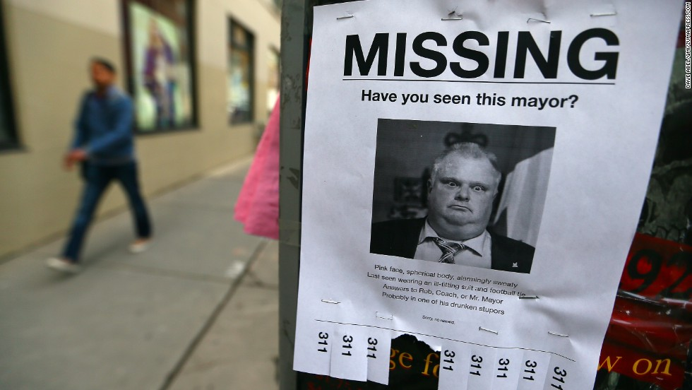 "Toronto Mayor Rob Ford is seen on a mock ""missing person"" poster Wednesday, May 7, in Toronto. Hours after a local newspaper reported on a new video that allegedly shows Ford smoking crack cocaine, the mayor <a href=""http://www.cnn.com/2013/11/15/politics/gallery/rob-ford-controversy/index.html"">announced</a> April 30 that he would be taking a break from his duties and his re-election campaign to seek help for alcohol abuse."
