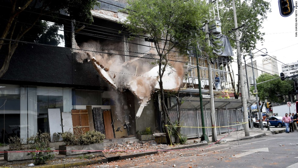 A wall damaged by the earthquake is demolished in Mexico City.