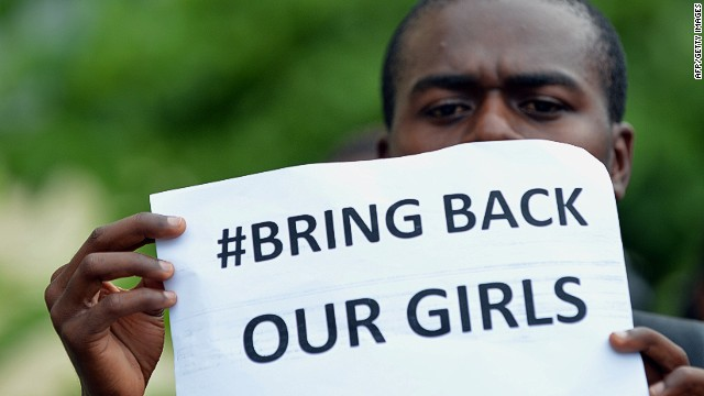 A participant at the World Conference on Youth 2014, holds a placard during a protest to demand the return of hundreds of school girls abducted by the Boko Haram separatist group in Colombo on May 9, 2014.