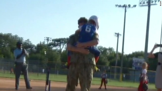 pkg soldier surprises daughter at softball game_00003208.jpg